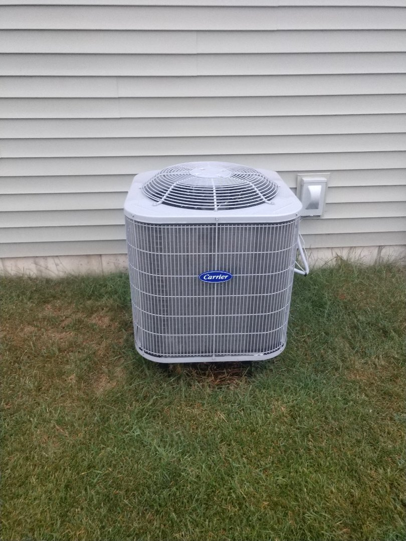 Woodstock, IL - This Carrier AC looking good as new after JD's clean and check.