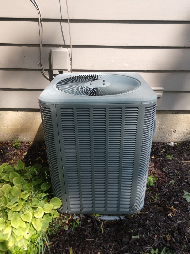 Woodstock, IL - JD making this customer's AC look like new after his clean and check.