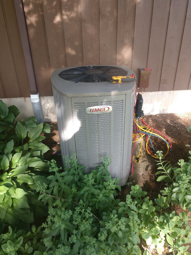 Woodstock, IL - JD's AC clean and check on a newer Lennox unit. Also pictured are his gauges for checking refrigerant charges.