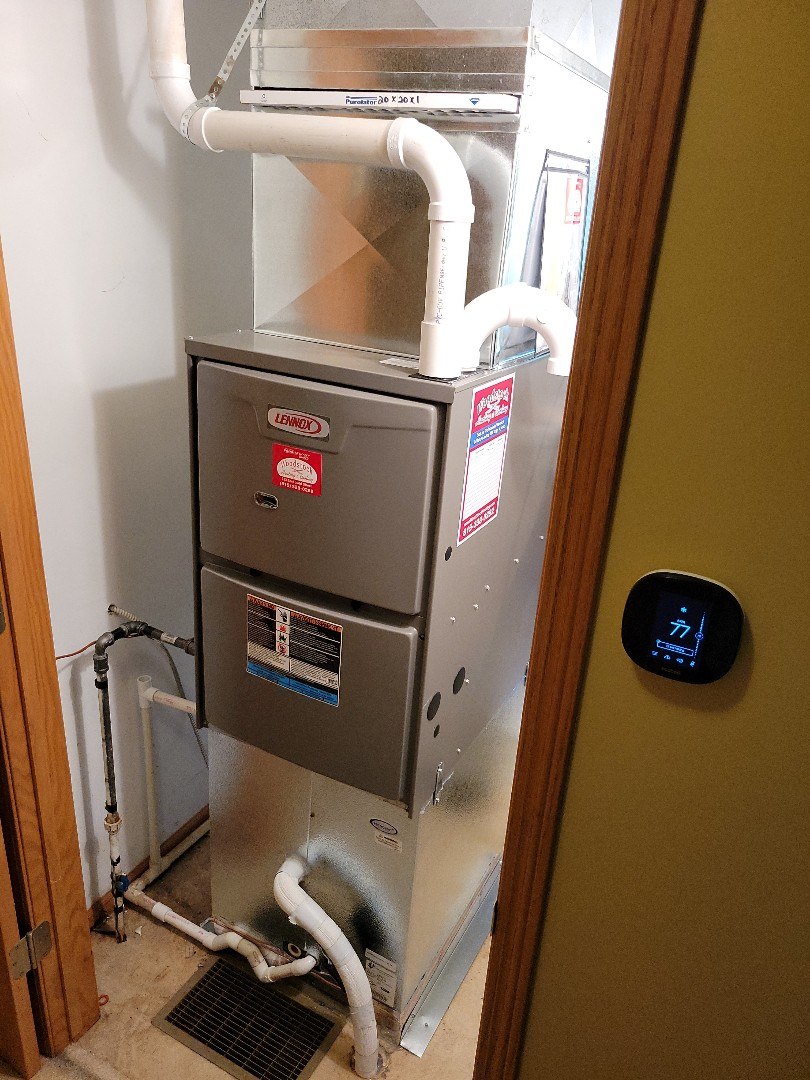 Harvard, IL - Whit and Alex's work of art of a full system install with a smart thermostat in Harvard. Some ductwork alterations were made to have a more efficient way of putting in and removing the furnace filter, as well as to get the coil to fit for this downflow system.