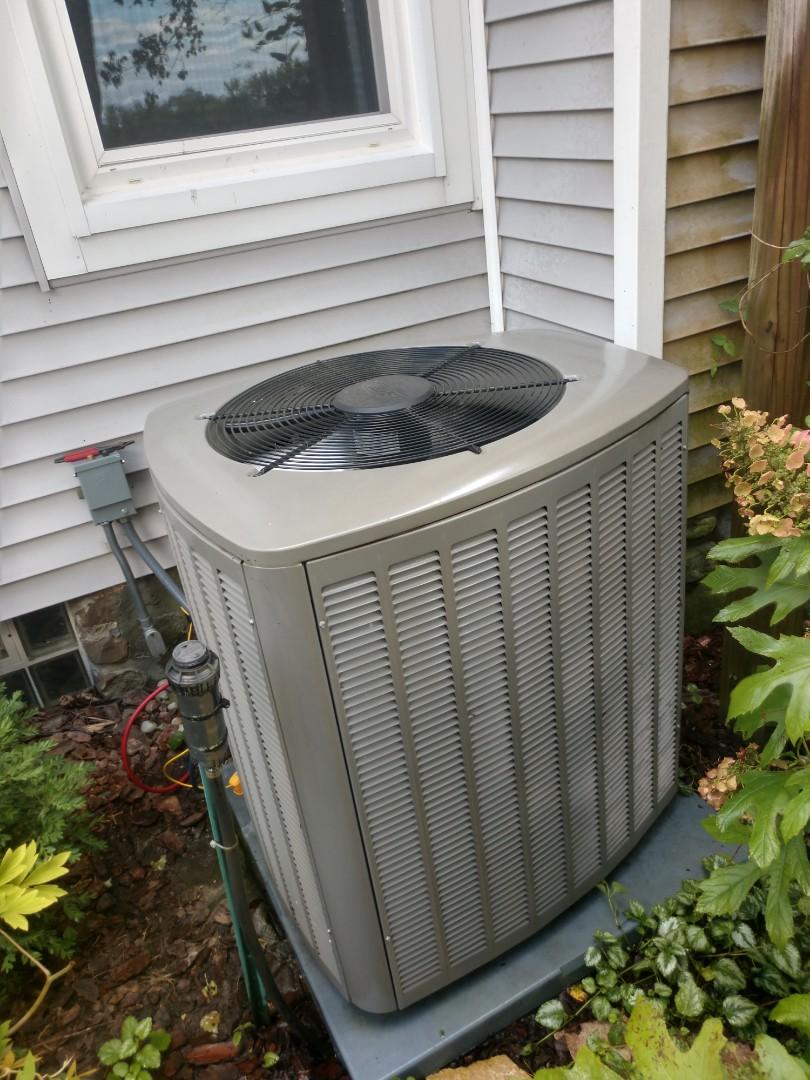 Harvard, IL - JD performing an AC clean and check in Harvard. No defects noted at this time and this AC is ready to take on the rest of the cooling season.