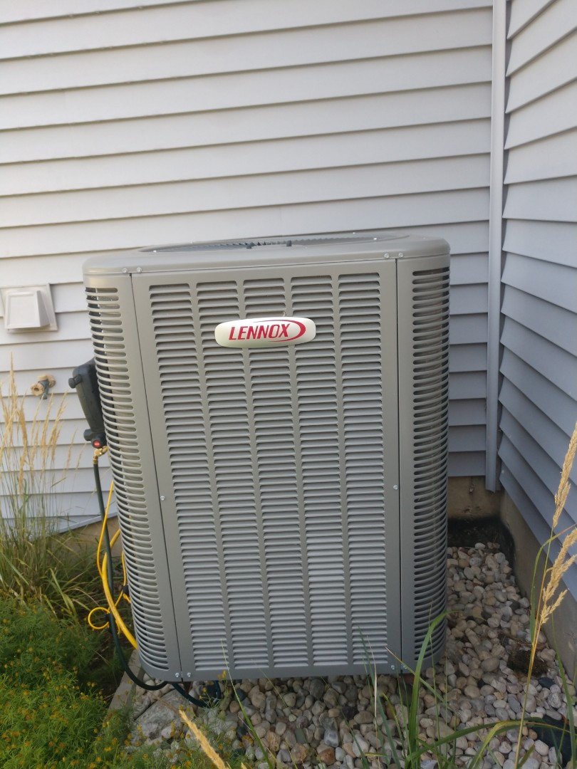 Woodstock, IL - JD performing AC clean and check right here in Woodstock on this newer Lennox unit. Everything is working efficiently at this time.
