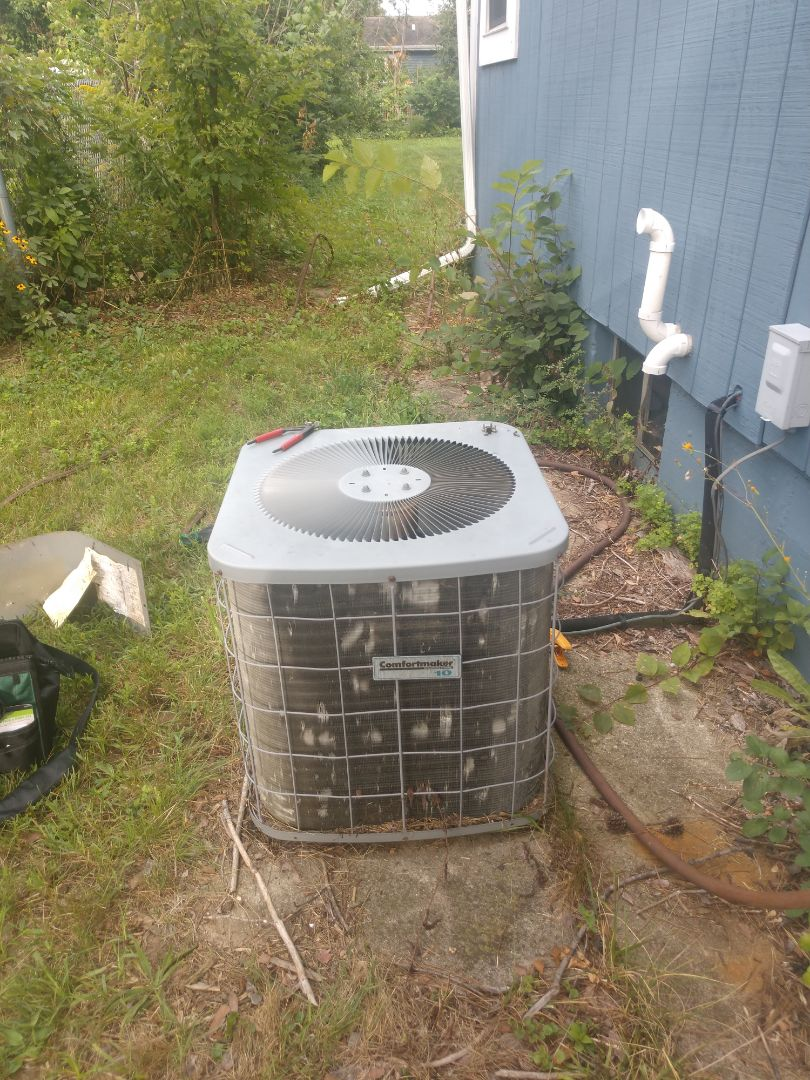 Wonder Lake, IL - The before photo of JD's AC clean to check in Wonder Lake. After he's finished there will be no debris stuck in the fins of the condensing unit.