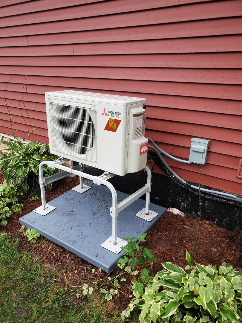 McHenry, IL - Alex's install of the condenser portion of a Mitsubishi Ductless system. Being a hyper heat model, it will maintain efficiency during the very cold winter days.