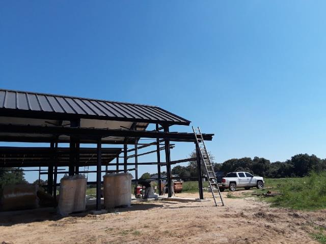 Harwood, TX - Metal Roof on a new construction steel building.  This is a trapezoidal standing seam panel.