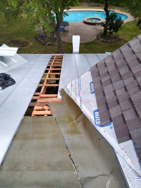 Austin, TX - RoofCrafters is the local contractor for roof repair.  We are experts in metal and shingle roofing, and were able to repair this tricky tie-in situation between the 2 materials.