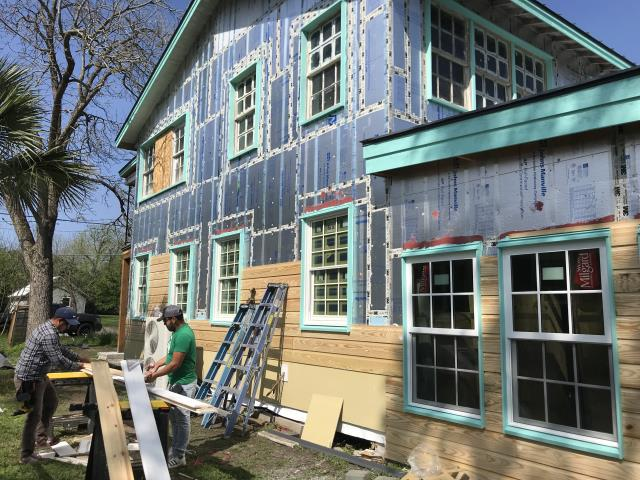 Lockhart, TX - Check out this very unique renovation going on in Lockhart, TX.  New pine siding is being installed over foam insulation and vertical batten strips.  RoofCrafters is well versed in all types of siding applications and can offer experience and solutions to all types of jobs.  Once this siding is complete and painted, it will be unrecognizable from the original look of the house.  When the metal roof is installed as well, this house will be top of the line on all sides and the roof.