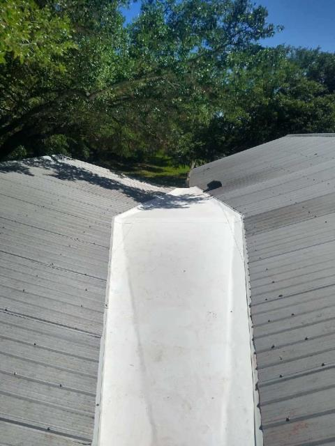 "Marble Falls, TX - Another challenging roof repair completed by the RoofCrafters team!  ""Dead Valleys"" are known to be difficult areas to keep dry, and often times are the source of leaks and costly repairs.  This dead valley used to be a flat area of water collection and leaking.  RoofCrafters build a custom cricket to divert water, and installed IB roof membrane before tying back in the original metal roofing.  Leak repaired!"
