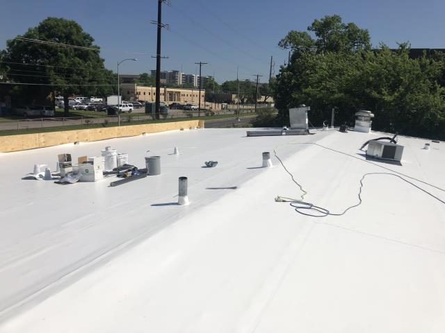 Austin, TX - RoofCrafters is installing this PVC roof membrane on a commercial buildng in Central Austin.  It had leaked for years with the old, screw down metal roof.  Now this low slope roof has a 20 year warranty that is backed by the manufacturer, IB roof systems.  Call RoofCrafters when you need a qualified roofing contractor in Austin.
