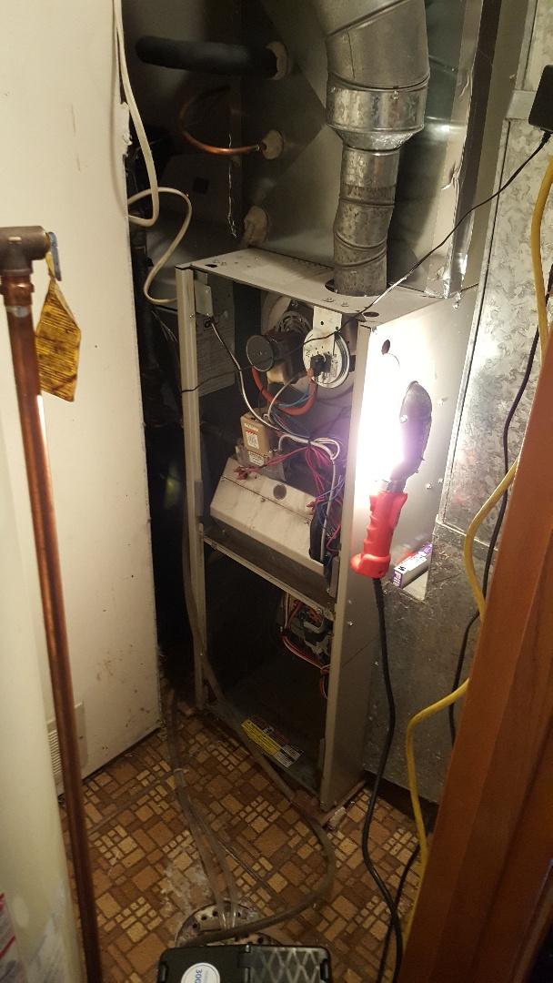 Davis, IL - Seasonal furnace inspection on a Heil furnace.