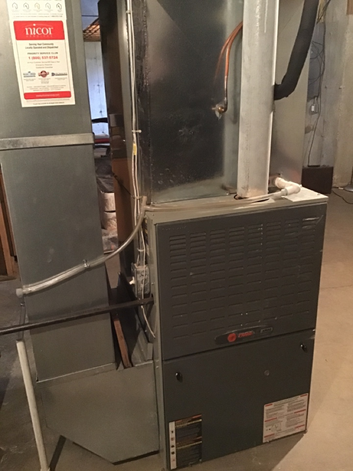 Loves Park, IL - Good morning Loves Park. Here today for an annual clean and check on this Trane furnace and one of our Nicor Pivotal Home Solutions customers.