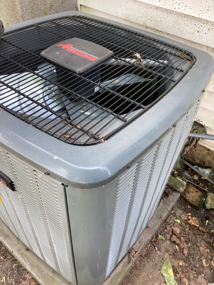 Pecatonica, IL - Seasonal air conditioner maintenance on this Amana system.