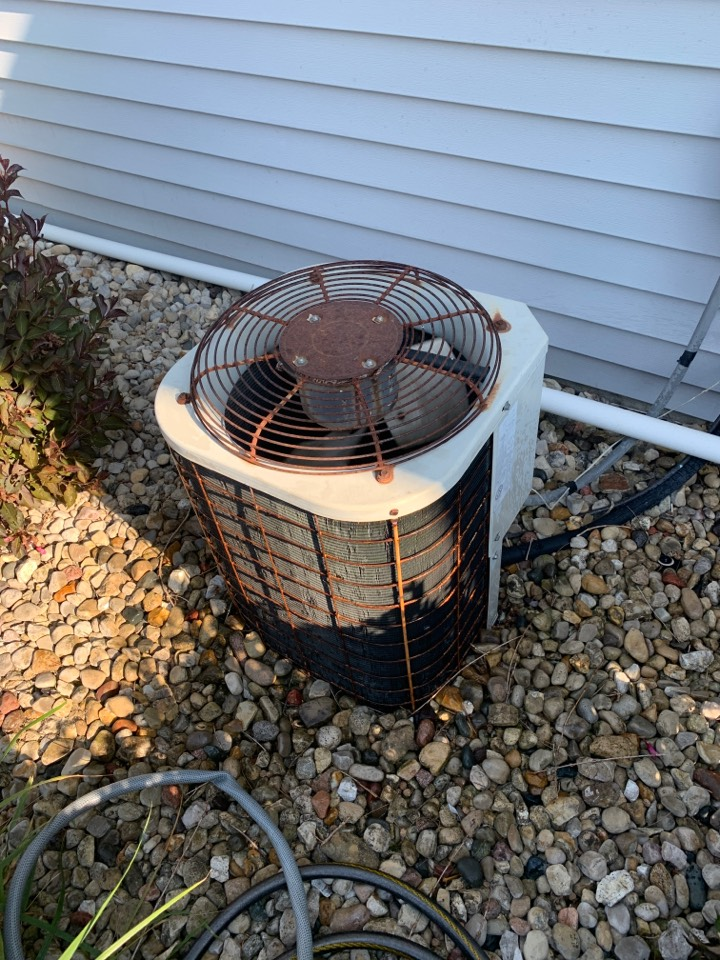 Winnebago, IL - Here for an annual clean and heck for this Bryant air conditioner and one of our PHS customers.