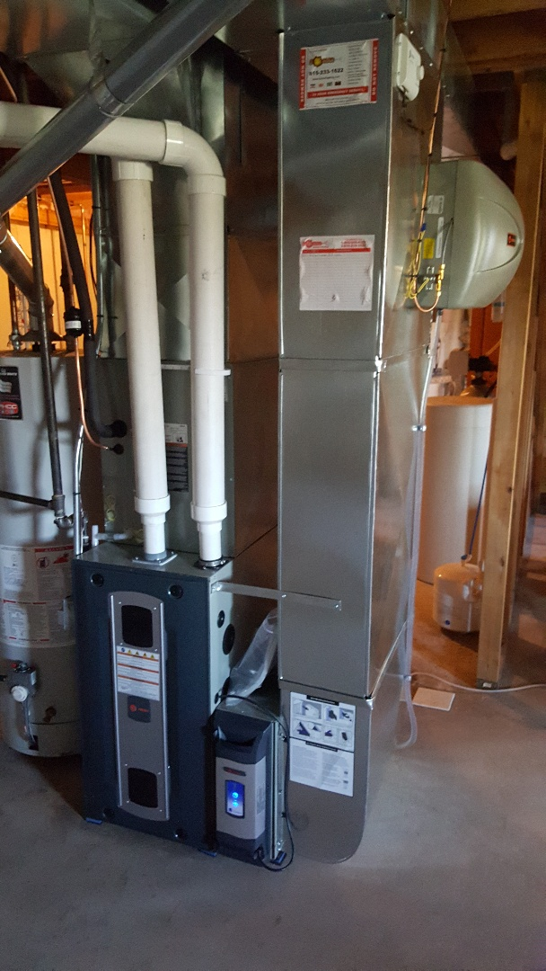 Winnebago, IL - Furnace air conditioner Aprilaire humidifier Reme Halo uv light and Trane Clean Effects air cleaner install. All high efficiency!