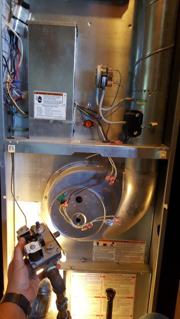 Pecatonica, IL - Seasonal maintenance on a Coleman mobile home furnace. Checking for a spider web!