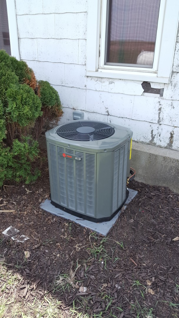 Ridott, IL - Air conditioner installation. Trane unit out in the country.