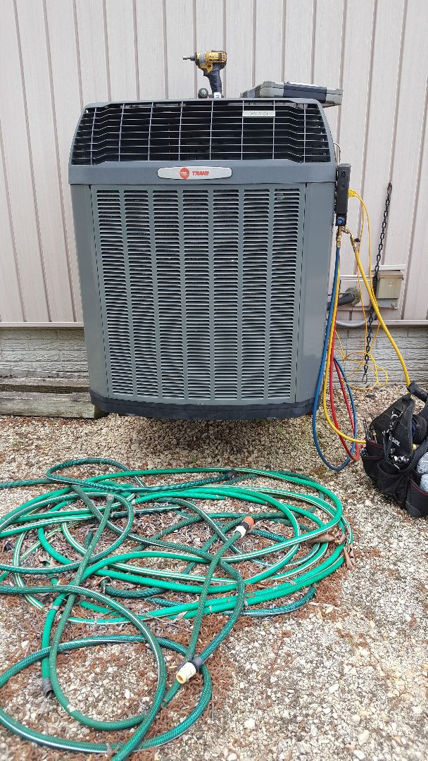 Lanark, IL - Seasonal maintenance on a Trane air conditioner. Look it's levitating!!!