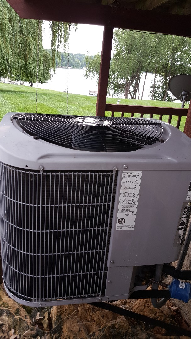 Lanark, IL - Seasonal maintenance on a carrier air conditioner. I'll be honest, all I see is the lake.