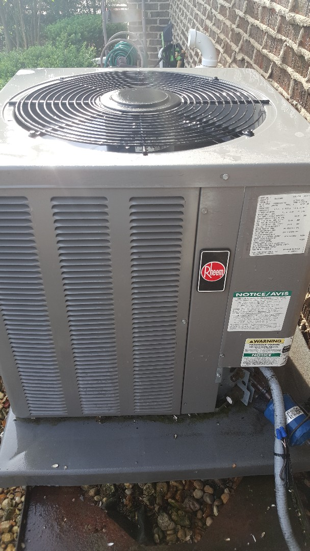 Freeport, IL - Seasonal maintenance on a Rheem air conditioner. You will get rheemed if you don't properly maintain your unit!