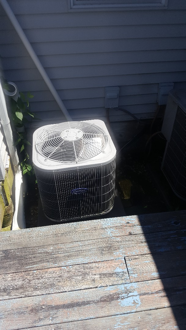 Stillman Valley, IL - Annual Carrier air conditioning maintenance inspection and cleaning