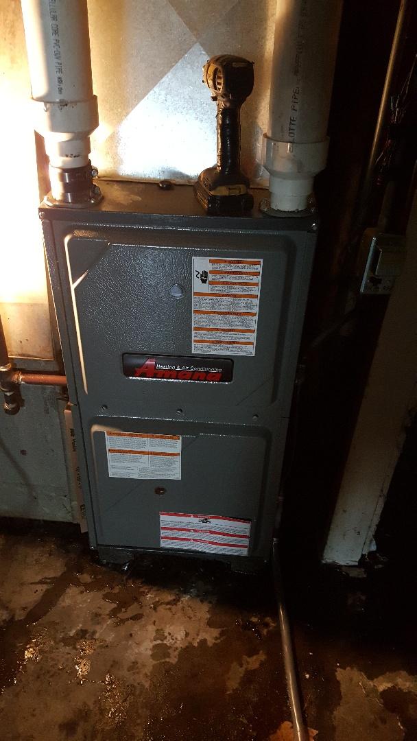 Freeport, IL - Seasonal maintenance on a Amana furnace.