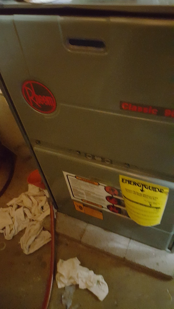 Freeport, IL - Seasonal maintenance on a Rheem furnace. Don't be rheemed with out heat. Call us for your seasonal inspection!
