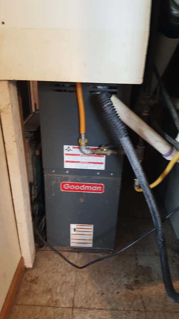 Machesney Park, IL - Furnace repair on a Goodman furnace. Bit of a tight space I might say!