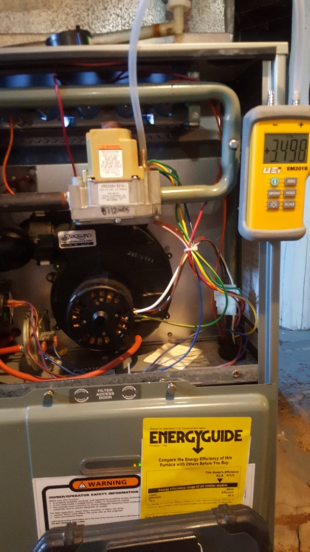 Warren, IL - Annual maintenance inspection on a Ruud high efficiency gas furnace