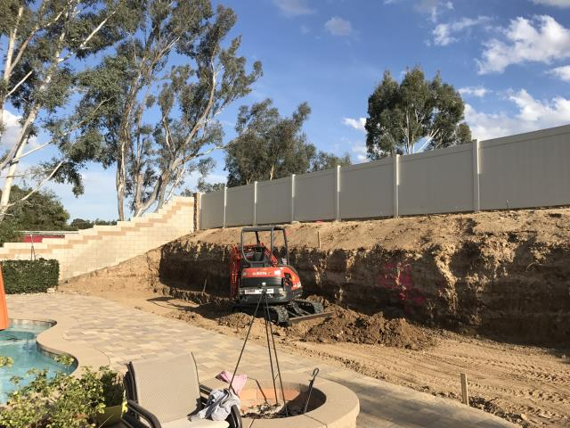 Winchester, CA - Large landscape project that includes a 90' retaining wall, custom stamped colored concrete and a custom horseshoe pit.