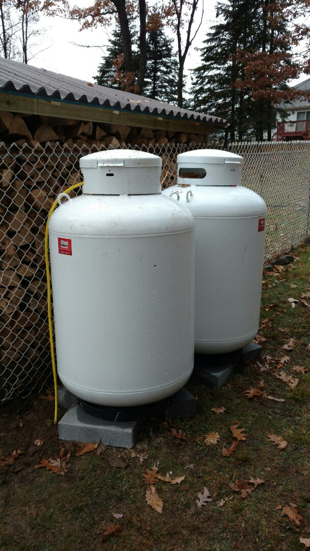 Mount Pocono, PA - Set two propane tanks for heating and cooling system.