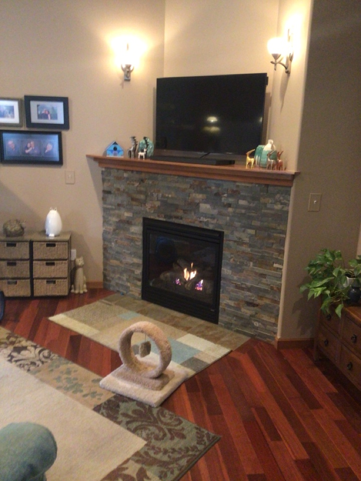 Lit pilot for customer on fireplace