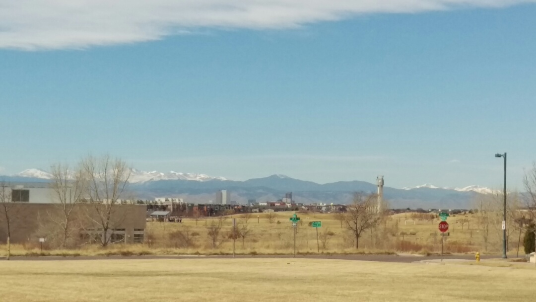 Denver, CO - Meeting with a client to discuss replacing the old Rheem air conditioner with a new state of the art Trane. Beautiful view from Stapleton today!