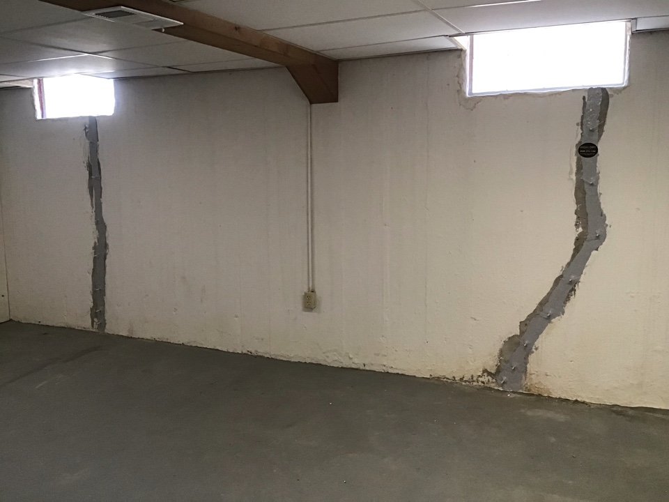 We used an epoxy / urethane injection method to waterproof two window cracks giving a transferable waterproofing warranty, helping to sell this house!
