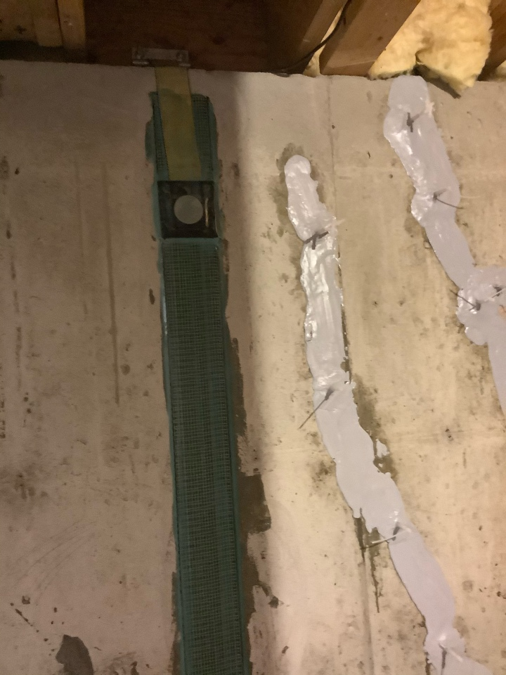Basement wall was moving. Now it's braced with carbon fiber straps.