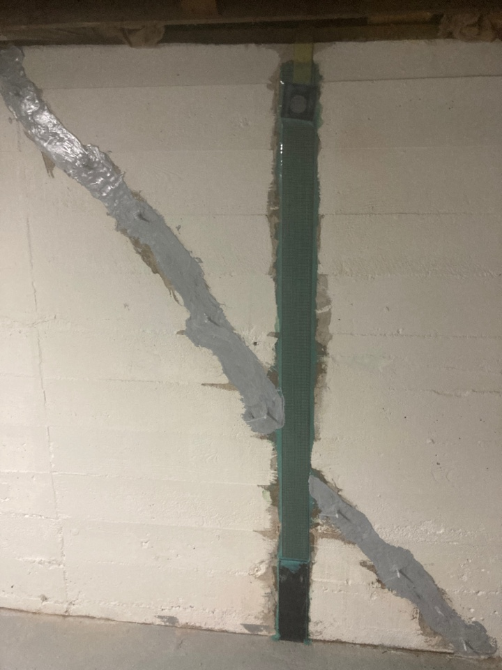 Kirkwood, MO - Waterproofing the crack. Using carbon fiber straps to brace and strengthen the wall from leaning.