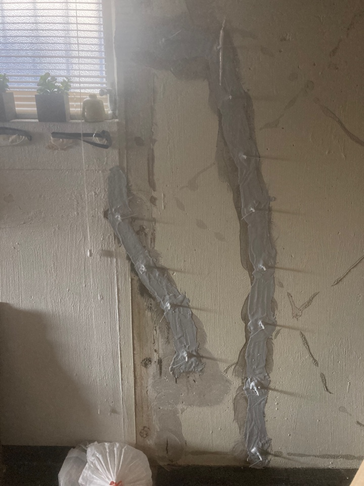 St. Louis, MO - Waterproofing two cracks in foundation wall.