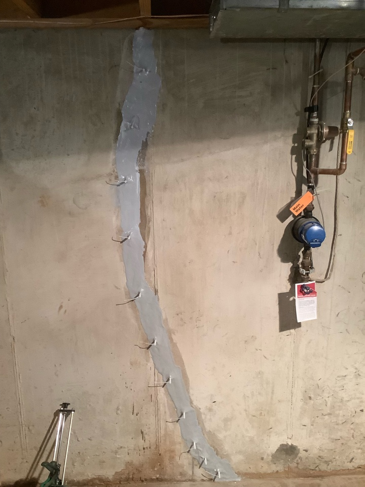 Ballwin, MO - This small crack was leaking a lot. The urethane injection will stop the water from getting inside the basement.