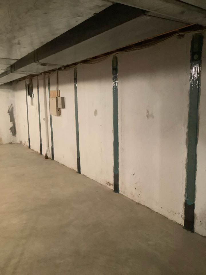 This wall was leaning into the basement. Carbon fiber straps will brace this wall and keep it from moving.