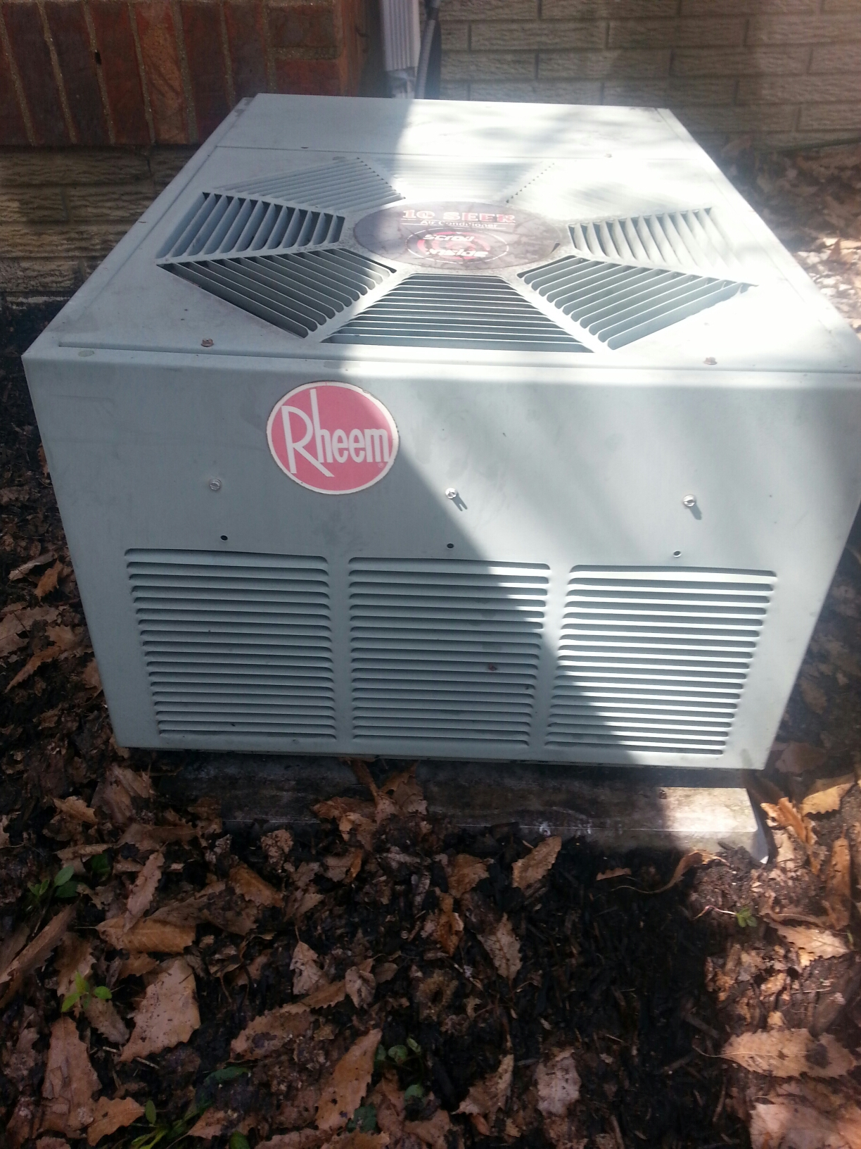 Reynoldsburg, OH - Working on an older Rheem air conditioning unit.
