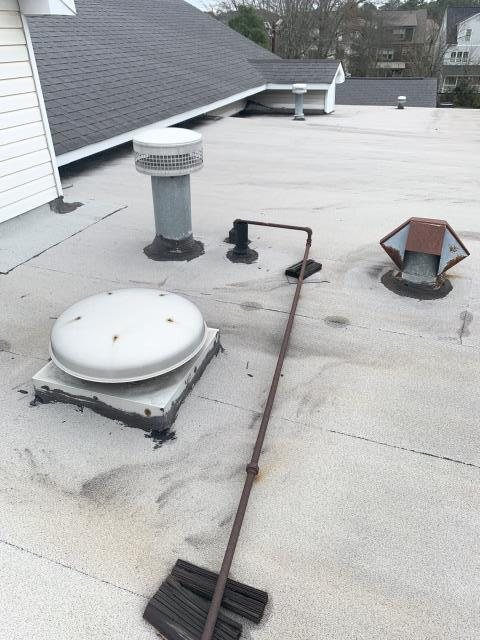 Woodstock, GA - Commercial Roof Repair - There are multiple penetrations through the modified bitumen roof that will have to be re-flashed with torch grade modified bitumen and sealed with Karnak Ultra 19