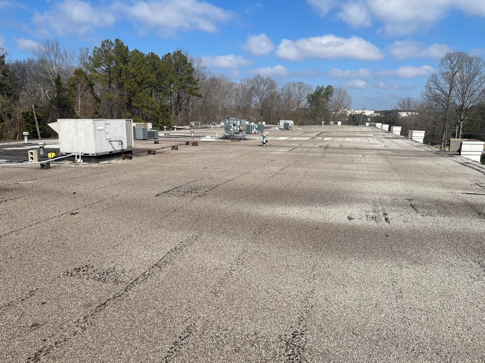 """Roswell, GA - Flat roof - multiple leaks on a commercial roof that is at the end of its life. The gravel will be removed, a 1"""" recovery board will be installed and a mechanically attached GAF TPO roof system will be installed with a 20 year manufacturer's warranty."""