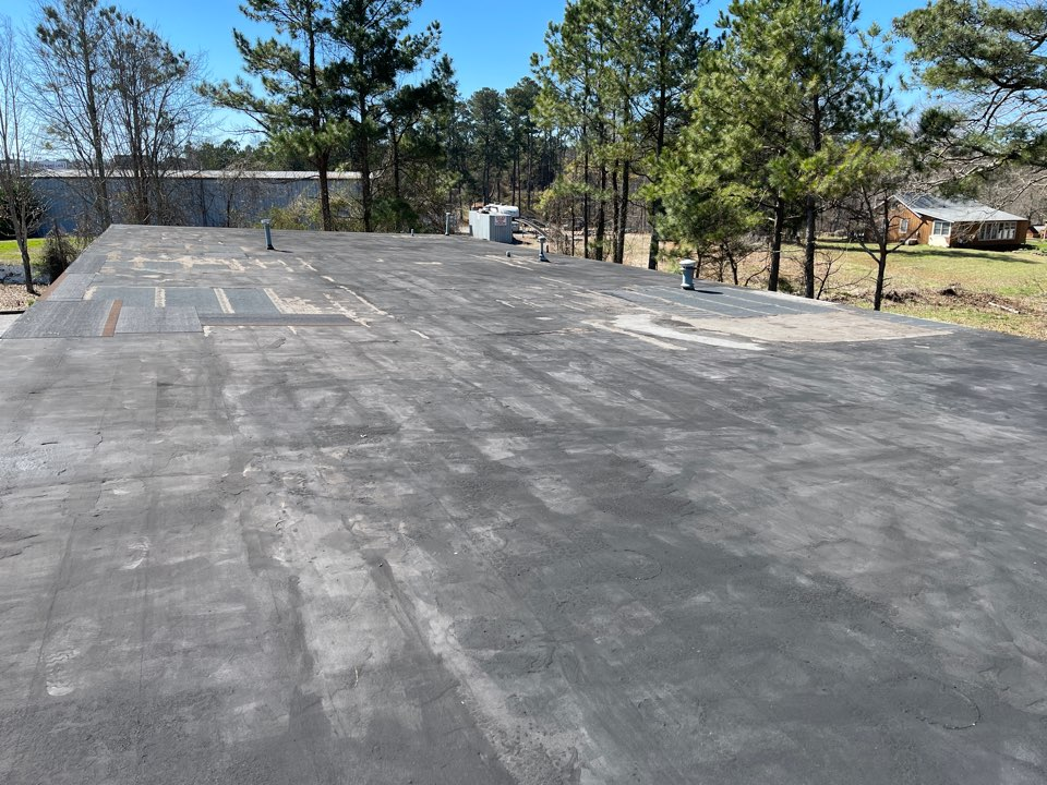Alpharetta, GA - Commercial Roof Repair - the built up roof is at the end of its life. Repairs using HydroStop elastomeric coatings will be made to stop current leaks until weather will permit a complete replacement using GAF EverGuard 60 mil TPO