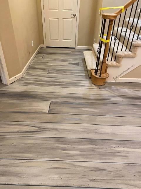 This decorative wood floor coating is really amazing! Xtreme Concrete Coatings is able to get the floor to turn out the exact shade you want so that it complements the whole room. The floor looks incredibly real, and the designs made in the wood look beautiful!