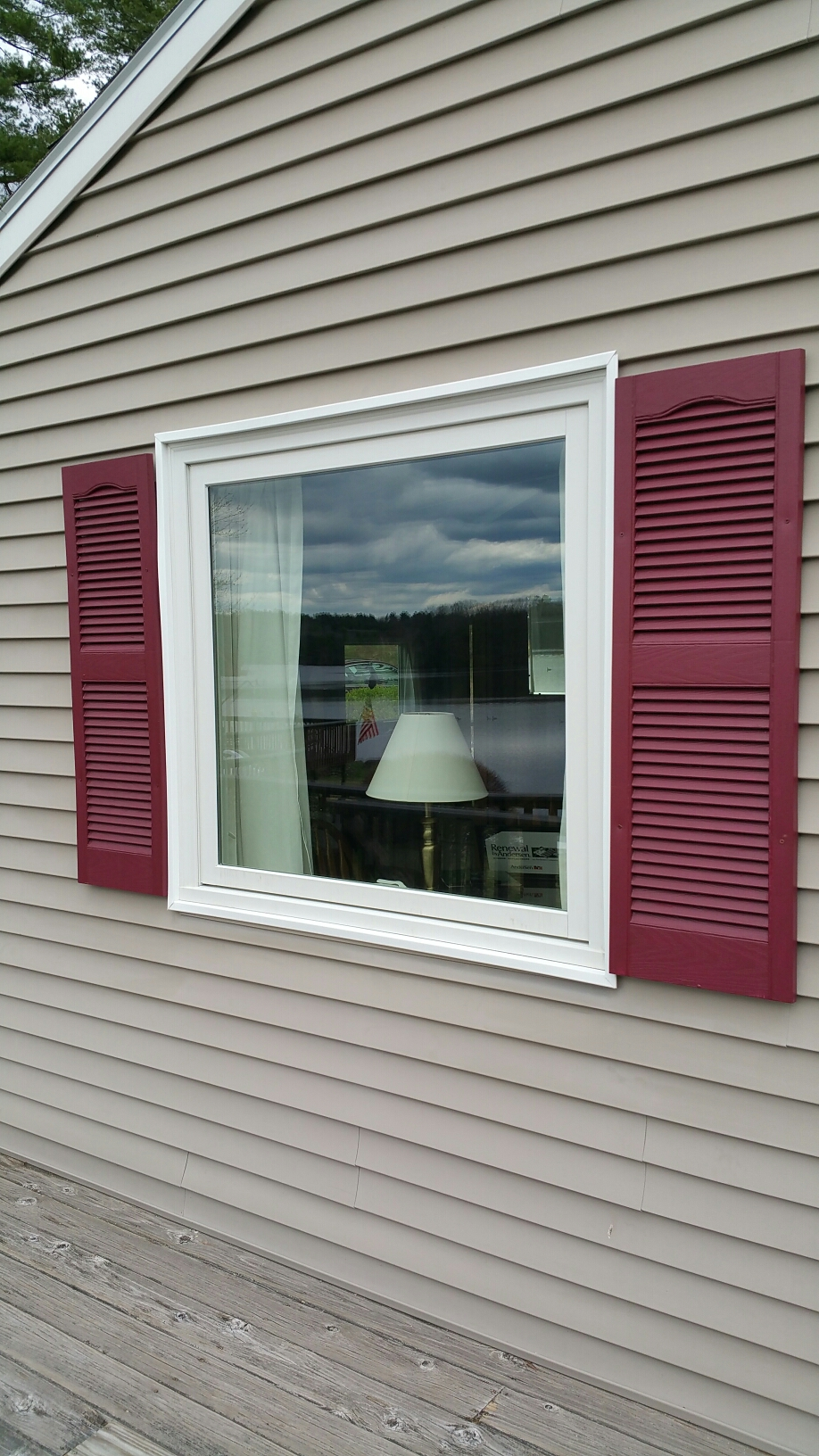 Woodstock, CT - Gorgeous new Renewal by Andersen awning window that replaced two side by side double hungs. What a view of the lake this customer now has!
