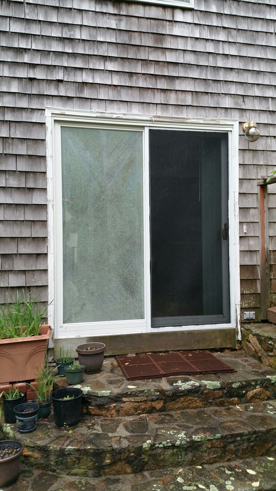 Providence, RI - Think it's time to replace this patio door? This couple did? Let Renewal by Andersen update and beautify your patio door entrance with gorgeous options and hardware to choose from + Andersen's exclusive start to finish installation process. Do it once, do it right.
