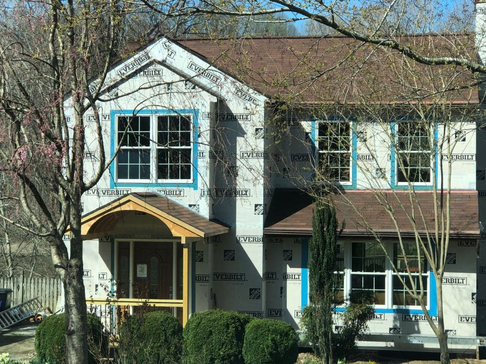 Chesapeake Beach, MD - New siding, James Hardie fiber cement siding Boothbay blue Cedar Mill with white band board