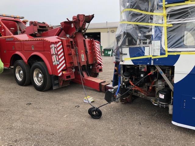 Loading a wrecked bus onto a Landoll trailer. Heavy duty towing. Heavy duty hauling and loading. Heavy duty winchout.