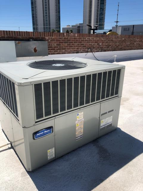Las Vegas, NV - Repair Install new indoor blower motor with new run capacitor for 3 ton American Standard rooftop heat pump AC unit.