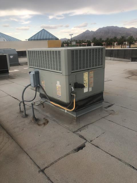 Las Vegas, NV - Installation of a new indoor blower motor and run capacitor for an American Standard 5 ton 3 phase commercial gas pack AC heating unit.