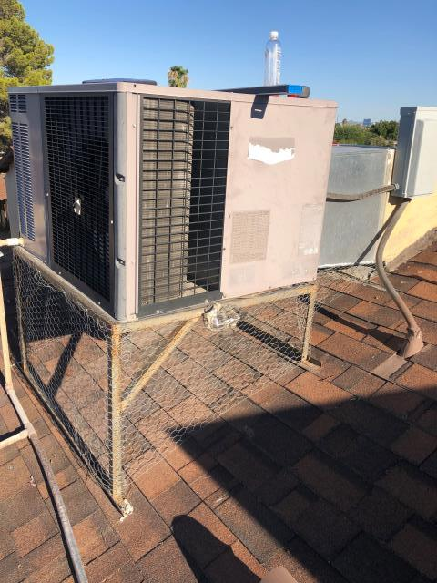 Las Vegas, NV - Install new indoor blower motor and run capacitor for Carrier 3 ton R22 Freon rooftop heat pump A/C unit.